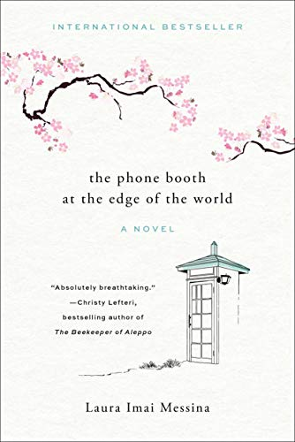 """A white book cover with a black and white phone booth and pink cherry blossoms, titled """"The Phone Booth at the Edge of the World."""""""