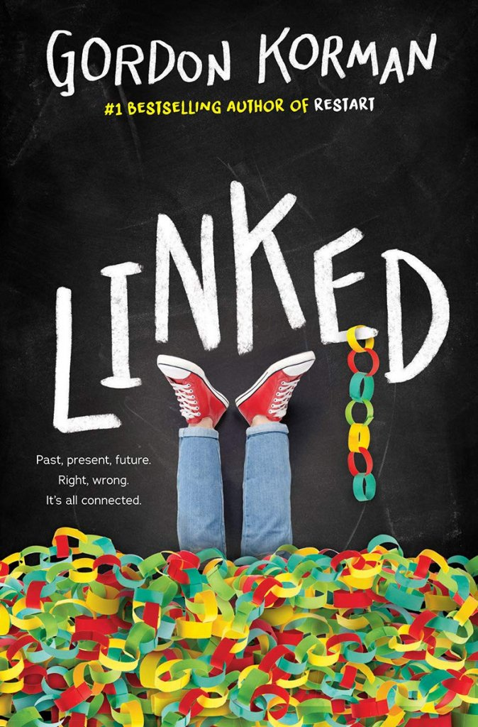"""A black book cover with two feet sticking up in red converse, surrounded by paper chain links, titled """"Linked."""""""